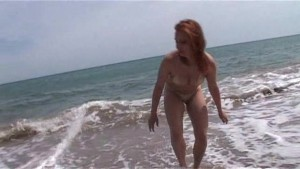 Eva gets washed by the surf