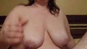 Handjob while looking at my tits