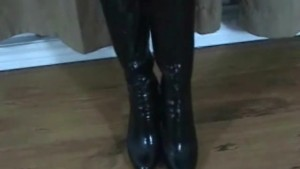 Fishnet socks and black boots