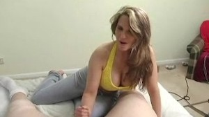 girl with huge tits stroking a tiny cock