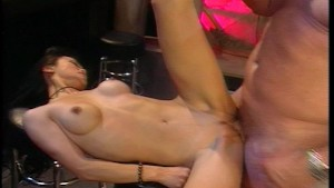 She hangs upside down and sucks his cock while he licks her pussy.