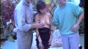 Two guys examine her titties