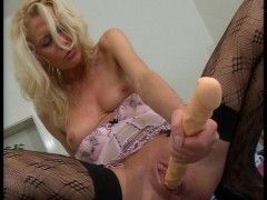 Picture Blonde uses her hands to get hot CLIP
