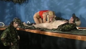Blonde babe interrogated by 2 Soldiers!