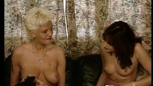 Two lessies caressing each others breasts
