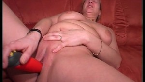 Chunky blonde gets excited with a red dildo