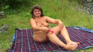 shorny slut timulating and rubbing her pussy in the nature on the meadow