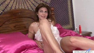 Milf In Lingerie Fucks A Red Dildo