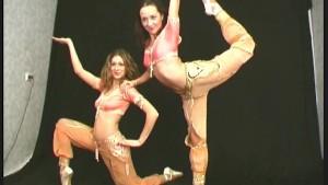 Two ballerinas shows flexible excersises
