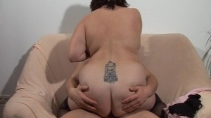 Large and lovely lady sits on
