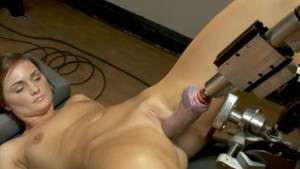 Blond girl machine fucked in a
