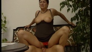 Short haired lady sits on a cock