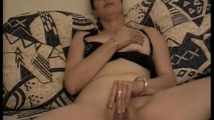 Mature lady rubs her clit then