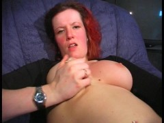 Red haired beauty fiddles with herself