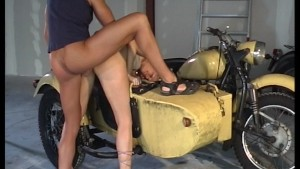 Biker fucks her on the sidecar