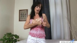 Horny Cougar Rubs Her Busty Tits And Masturbates