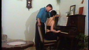 Piano teacher plays a perfect melody