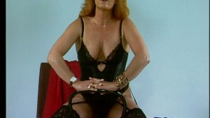 Mature redhead poses for pictu