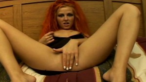 Hot little red head plays with
