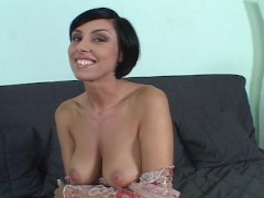 Sexy brunette fiddles with her clit