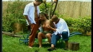 Two guys and a girl play with their yard tools