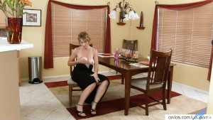 Elegant housewife Masturbates In Her Gown