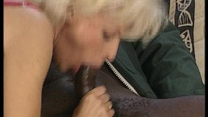 Older blonde loves the black cock.