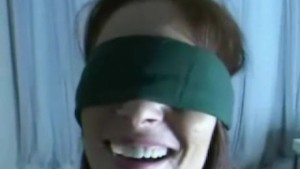 Blindfolded wife gives blowjob