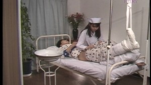 Asian nurse takes proper care of her patient