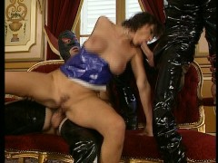 Brunette with two masked latex men