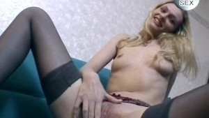 Cute blonde in pantyhose stripping and playing