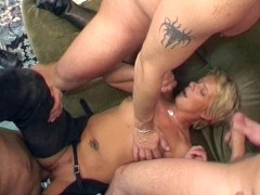 Biker blonde takes on three guys