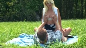 Blonde MILF on a picnic blanke