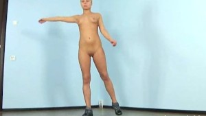 Blonde girl stretching nude
