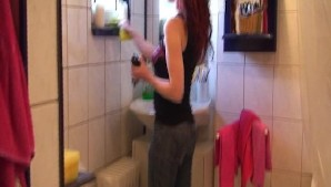 Cleaning the house and pleasing her man