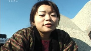 Asian girl plays and pees at the beach