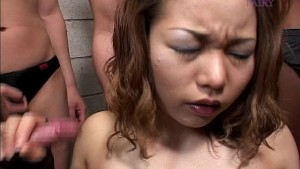 Asian girl on her knees for many guys