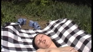 Sandra lays down to masturbate by the train tracks