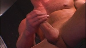 Hunk jerking off in a bar