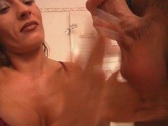 Rough handjob in the bathroom