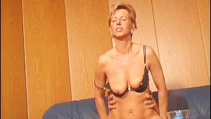 German MILF gets candles in her holes
