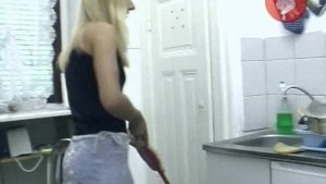 Blonde maid pees and inserts toilet brush