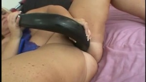 chubby babe playing with a big snake