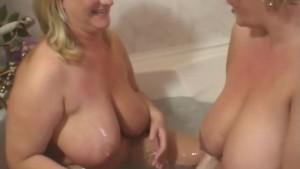 Two Big Tits Lesbians Have Fun In A Bath