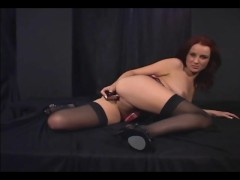 Redhead masturbates in sheer stockings and heels