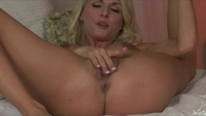 Hot busty blonde babe rubs and finger-fucks wet pussy to orgasm