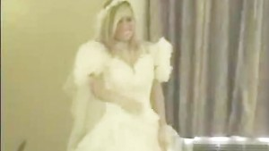 Girl in wedding dress sucks a cock and strips