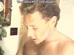 Lady pets dick with mouth and pussy