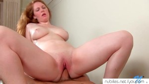 Busty redhead gets tit-fucked
