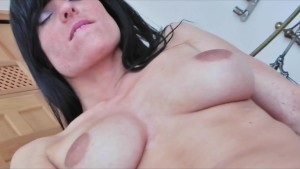 Playful brunette bombshell loves to get naked and rub her pussy